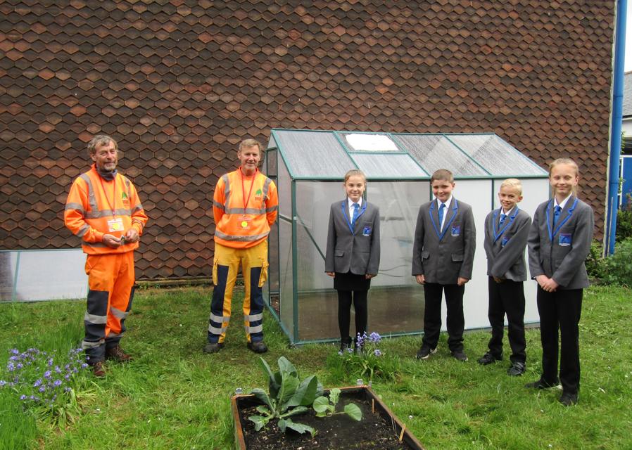 Council lends a hand building school greenhouse